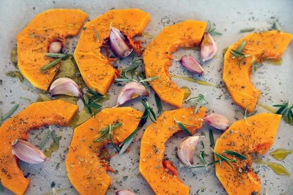 Baked pumpkin with herbs and extra virgin olive oil