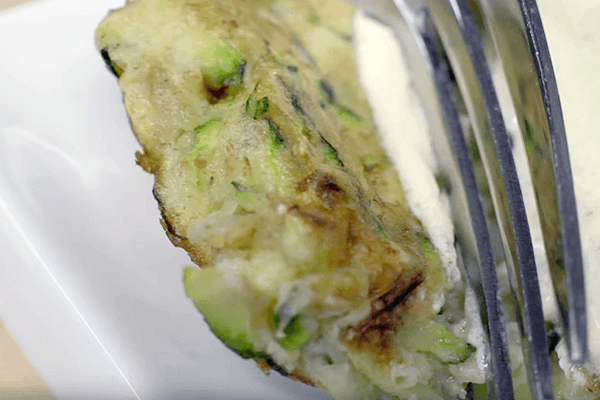 Dish detail of Zucchini fritters with yogurt sauce