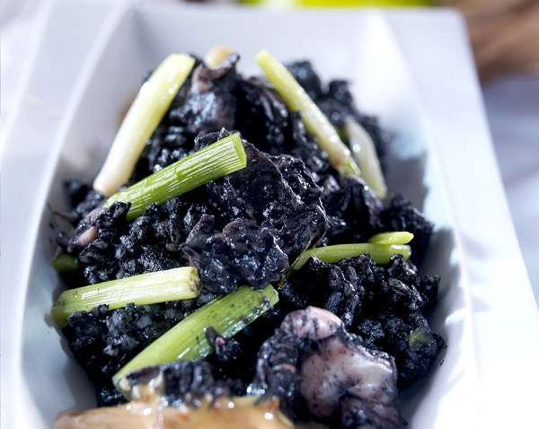 Black rice with cuttlefish and garlic shoots recipe
