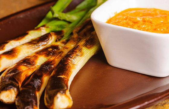 Grilled mexican green onions with Romesco sauce