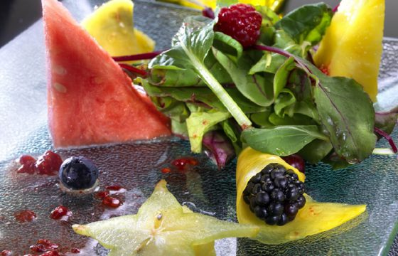 Seasonal fruit salad with raspberry vinaigrette