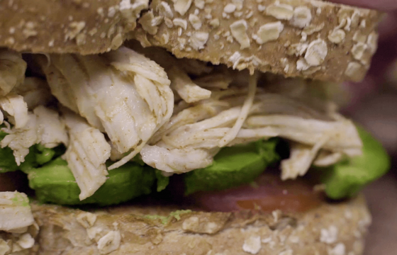 Shredded chicken, paprika and avocado sandwich