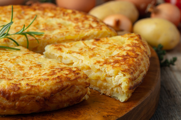 The classic Spanish potato tortilla recipe includes onion